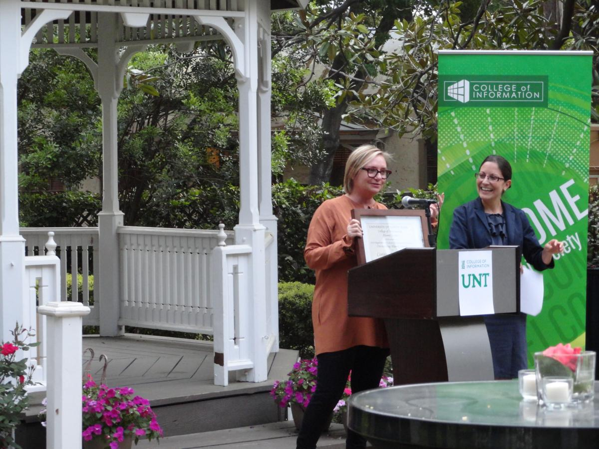 Corinne Hill recieves award from Michele Villagran, Alumni Society President